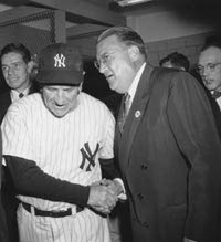 Yankees Manager Casey Stengel extends his congratulations to Dodger President Walter O'Malley following the 1955 World Series. Stengel's Yankees had defeated the Dodgers in the World Series in 1949, 1952 and 1953.