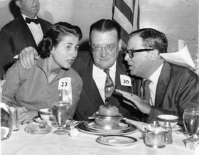 Rosalind Wyman, Los Angeles City Councilwoman, Fifth District and L.A. Mayor Norris Poulson (1953-61) with Walter O'Malley at a Dodger welcoming luncheon on Oct. 28, 1957. The persistent Wyman and Poulson were two of the driving forces in gaining Walter O'Malley's attention to consider Los Angeles as a new home.