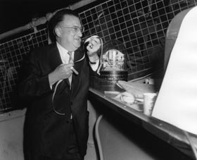 "On June 3, 1958, Walter O'Malley checks his ballpark ticker-tape machine for results of ""Proposition B"" voting in Los Angeles. The news wound up good for the Dodgers and the City of Los Angeles, as the referendum passed."