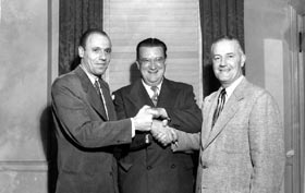 "E.J. ""Buzzie"" Bavasi (from left) and Fresco Thompson join forces with newly-named Dodger President Walter O'Malley on Oct. 26, 1950. O'Malley named both Vice Presidents, while Bavasi was also the General Manager and Thompson was also Director, Minor League Operations."