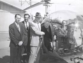 On May 2, 1957, Walter O'Malley takes a 50-minute helicopter ride to view prospective sites for Dodger Stadium. From left is Los Angeles County Supervisor Kenneth Hahn, Undersheriff Peter Pitchess, Del Webb, co-owner of the New York Yankees, O'Malley and pilot Capt. Sewell Griggers at Biscailuz Center.