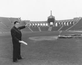 Walter O'Malley surveys the mammoth Los Angeles Memorial Coliseum for temporary use by the Dodgers beginning with the 1958 season. On January 15, 1958, he is standing where he believes home plate would be located. Ultimately, the Dodgers would play four seasons in the Coliseum until O'Malley's dream ballpark, Dodger Stadium, opened on April 10, 1962.