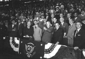 Walter O'Malley watches President Eisenhower throw out the ceremonial first pitch prior to the first game of the 1956 World Series at Ebbets Field on October 3.
