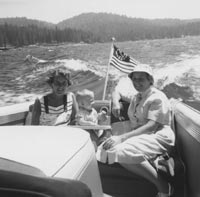 Terry O'Malley Seidler, son John and Kay O'Malley enjoy a family boat ride on Lake Arrowhead, CA in 1959.