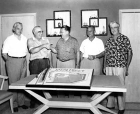 Inspecting a model of Holman Stadium at Vero Beach include (from far left) architect Emil Praeger, Vero Beach businessman and Dodger director Bud Holman, and Walter O'Malley.