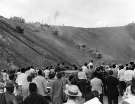 Bulldozers begin the mammoth leveling and grading process of the site as soon as ceremonies are completed on Sept. 17, 1959.
