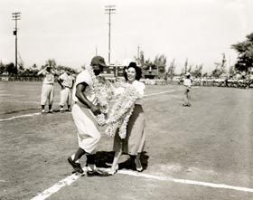 Jackie Robinson received a flower lei during an exhibition game in Hawaii.