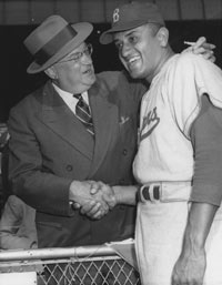 Walter O'Malley greets Don Newcombe, the 1956 National League MVP and Cy Young Award winner.