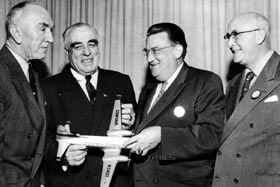 From left, Chairman of the Board of Eastern Air Lines Capt. Eddie Rickenbacker, Bud Holman, Walter O'Malley and Dodger stockholder James Mulvey hold a Convair model plane.