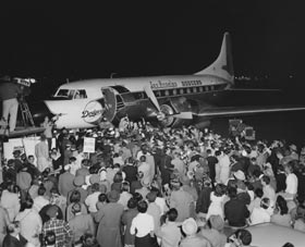 Fans excitedly greet the new Los Angeles Dodgers, who land in their own airplane, upon their arrival at the airport.