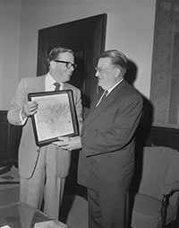 "Los Angeles Mayor Norris Poulson, left, and Walter O'Malley look over a map of Los Angeles at City Hall, October 24, 1957, prior to appearing before the City Council. Dodger executives and select players arrived the night before to a large welcoming crowd at LAX. The Dodger-owned Convair 440 Metropolitan airplane had been repainted with ""Los Angeles Dodgers"" to mark their arrival to their new home."