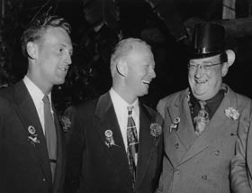 Dodger broadcasters Vin Scully and Red Barber with Walter O'Malley at the Dodgers' 1952 St. Patrick's Day party.