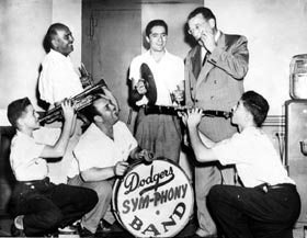 "Walter O'Malley sits in with the Dodger ""Sym-Phony"" band."