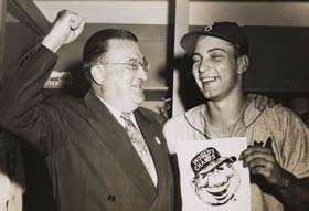 Walter O'Malley celebrates the Dodgers' first championship in Brooklyn history with pitcher Johnny Podres, who pitched a complete victory in a 2-0 triumph over the New York Yankees in Game 7 of the 1955 World Series at Yankee Stadium.