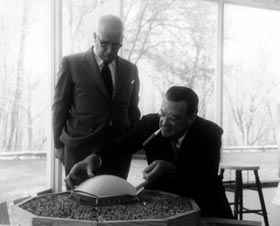 Walter O'Malley and architect R. Buckminster Fuller view a model of a proposed domed ballpark.