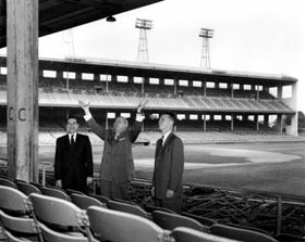 Dodger official Dick Walsh (right) views Wrigley Field in Los Angeles, owned by Walter O'Malley, as a possible home field for the Dodgers in 1958. Cubs' Vice President Clarence Rowland (center) and  Angels' G.M. Bill Heymans is on the far left.