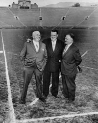 At the Rose Bowl in Pasadena, (l-r) National League President Warren Giles, Walter O'Malley and Pasadena City Manager Don McMillan stand where home plate is to be located for baseball.