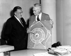 Walter O'Malley and Captain Emil Praeger inspect the model of the new 56,000-seat Dodger Stadium.