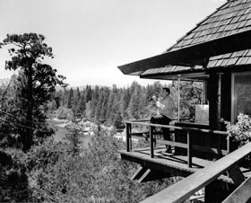 Walter O'Malley admires the view from his Lake Arrowhead chalet, located exactly one mile high.