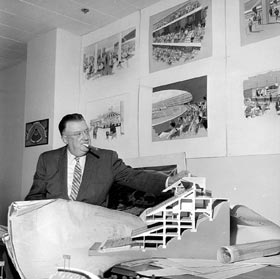 "Walter O'Malley, surrounded by models, blueprints and artist sketches of the new Dodger Stadium. He was actively involved in each and every phase of the construction of his ""dream"" stadium."