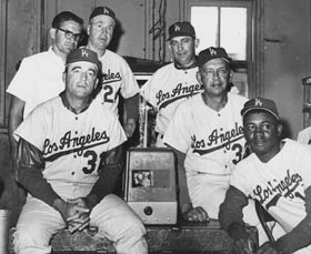 (Clockwise from bottom left): The 1965 Dodger staff included Coach Preston Gomez, Trainer Bill Buhler, Manager Walter Alston, Coach Lefty Phillips, Coach Danny Ozark and Coach Jim Gilliam.
