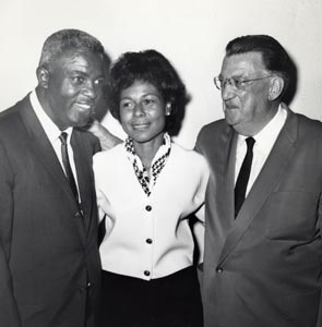 Jackie Robinson and his wife Rachel with Walter O'Malley.