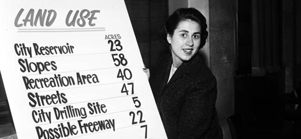 Los Angeles City Councilmember Rosalind Wiener Wyman at age 22 was the individual most responsible for encouraging Walter O'Malley and the Dodgers to relocate. Here in council chambers, she reviews the potential land use for Dodger Stadium at a March 14, 1958 Dodgers hearing.