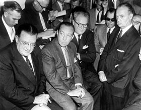 On June 4, 1957, Walter O'Malley appears at a press conference along with New York Mayor Robert Wagner, Giants President Horace Stoneham and Brooklyn Borough President John Cashmore.