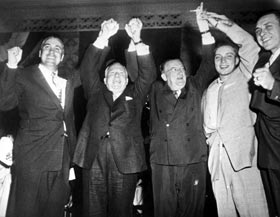 Walter O'Malley raises his arms in triumph following the 1955 World Series with (L-R) Dodger outfielder Duke Snider, National League President Warren Giles, pitcher Johnny Podres and first baseman Gil Hodges.