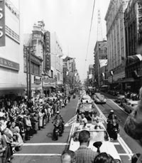 Thousands of fans lined the streets to greet their Los Angeles Dodgers, who traveled by motorcade to the Coliseum.