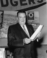 "Walter O'Malley explains the Dodgers' position on ""Proposition B"" in no uncertain terms to the voting public during a press conference on May 26, 1958."