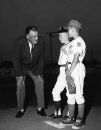 Future Dodgers? Walter O'Malley greets a pair of Little League Baseball players in Vero Beach, FL. O'Malley was a major supporter of the Little League programs, comparing its importance to the Boy Scouts of America. He served on the Board of Trustees for the Little League Baseball Foundation from 1958-79.