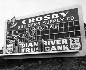 Dodger Manager Charlie Dressen (far left) and Walter O'Malley (second from left) stand in the Holman Stadium scoreboard in right field to promote the upcoming 1953 season.