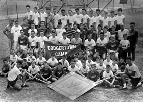 Citing year-round potential for the complex, Walter O'Malley launches the Dodgertown Camp for Boys. Campers at the initial 1954 session paid $500 for two months housing, all meals and sports instruction under the directorship of track star Les MacMitchell. Peter O'Malley was a 16-year-old camp instructor, while his sister Terry served as a secretary for the camp's administration.