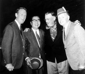 Vin Scully (l-r), Yomiuri Giants President Toru Shoriki, Walter O'Malley and Dodger broadcaster Jerry Doggett enjoy relaxing at the St. Patrick's Day party at Dodgertown.
