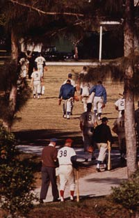 William P. Schweppe, Director, Minor League Operations and Monty Basgall, minor league instructor (foreground l-r), with players walking off the field from a camp game and heading back to the main building at Dodgertown, the end of another day in spring training.