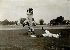 The double play duo of second baseman Jackie Robinson and shortstop Pee Wee Reese get their work done at Dodgertown.