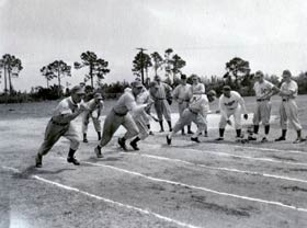 Branch Rickey's many baseball training techniques include a good old-fashioned track race between Dodger players.