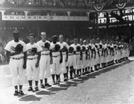 Jackie Robinson (fourth from left) joins his teammates for introductions on Opening Day at Ebbets Field on April 18, 1952. The Dodgers defeated the New York Giants, 7-6, that day. Robinson played 10 seasons for the Dodgers (1947-56) and was named Rookie of the Year (1947) and National League MVP (1949).
