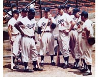 Top talent on the field pervaded the Dodger organization in the 1950s, including all-time greats (left to right) Pee Wee Reese, Carl Furillo, Jackie Robinson, Carl Erskine, Gil Hodges, Don Newcombe, Duke Snider and Roy Campanella, who unite to chat about baseball by the team's batting cage.