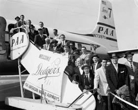 The Brooklyn Dodgers, along with other major league officials, depart New York City on the first leg of their trip to Japan.