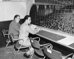 Walter O'Malley and King Faisal II of Iraq watch the Dodger game on Aug. 13, 1952 at Ebbets Field. It was the first baseball game that the young King had seen in person.