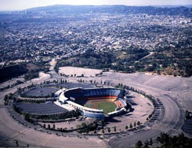 Dodger Stadium, with its terraced parking lots and multi-colored unobstructed view seats, and view to the northwest in 1994.