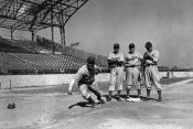 Pete Reiser breaking for home plate in Havana, Cuba.