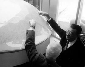 Inspired by a geodesic domed stadium model, Walter O'Malley asked R. Buckminster Fuller about the strength of one of his plastic structures at Huntington Station in Long Island, NY.