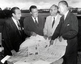 Walter O'Malley meets with New York City officials regarding a new ballpark in Brooklyn for the Dodgers on Aug. 19, 1955.  The meeting at Gracie Mansion included New York Mayor Robert Wagner (far left), Robert Moses, Parks Commissioner for the City of New York and Brooklyn Borough President John Cashmore (far right).