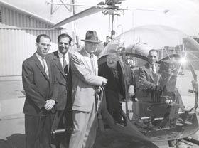 On May 2, 1957, Walter O'Malley takes a 50-minute helicopter ride to view prospective sites for Dodger Stadium. From left is Los Angeles County Supervisor Kenneth Hahn, Undersheriff Peter Pitchess, Del Webb, co-owner of the New York Yankees, O'Malley, and pilot Capt. Sewell Griggers at Biscailuz Center.