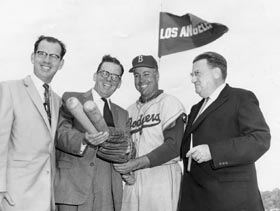 Los Angeles County Supervisor Kenneth Hahn, L.A. Mayor Norris Poulson, center fielder Duke Snider and Dodger President Walter O'Malley at Dodgertown in Vero Beach, FL on March 6, 1957. Los Angeles made a pitch to O'Malley in discussions there.