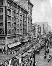 The Dodgers are welcomed to Los Angeles by thousands of fans on April 18, 1958, during an Opening Day parade and celebration through the city's downtown streets.