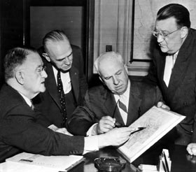 Obstacles with the Rose Bowl in Pasadena left Walter O'Malley two options to play in 1958 — Wrigley Field or the Los Angeles Memorial Coliseum. From left, Pasadena City Manager McMillan, Asst. City Manager Robert McCurdy, National League President Warren Giles and O'Malley.